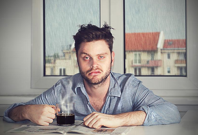 man suffering the effects of sleep apnea