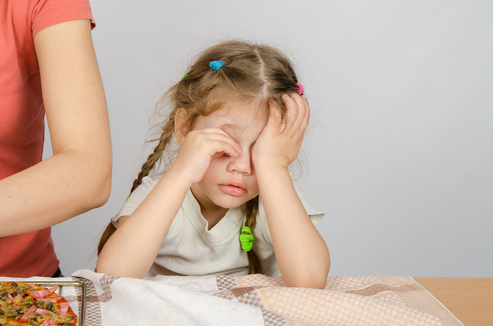 Children with sleep apnea have trouble sleeping and can be irritable and drowsy during the day.