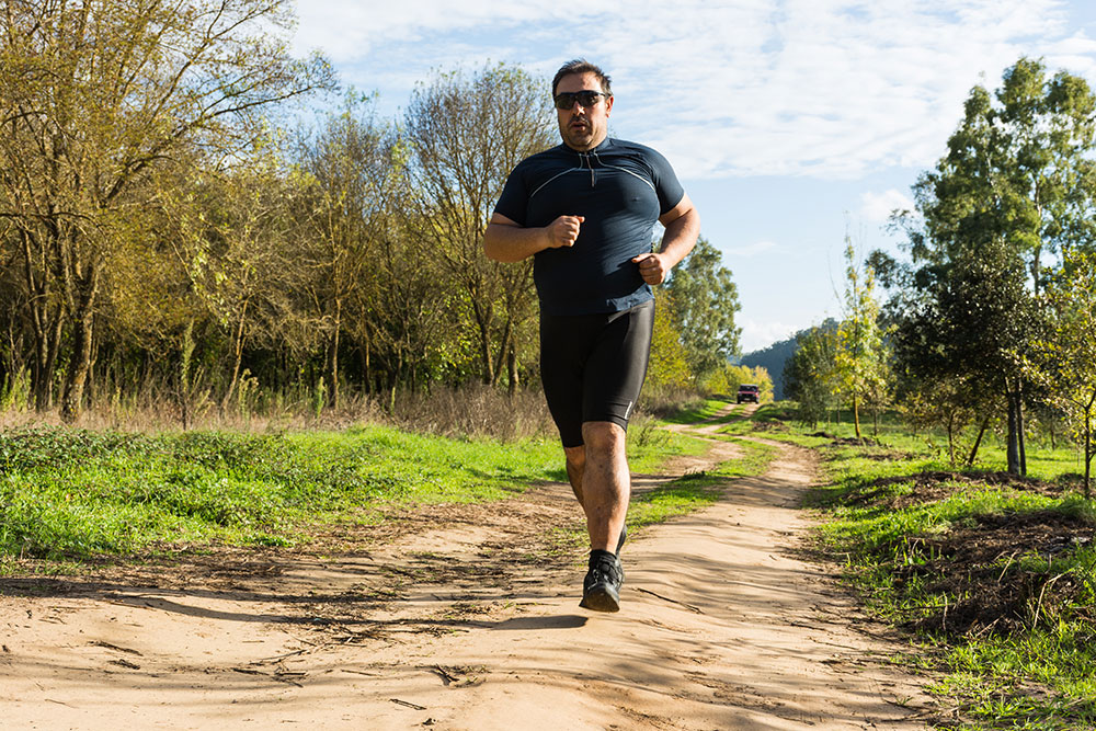 Overweight man jogs to help his sleep apnea.