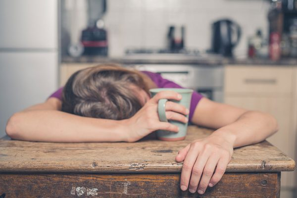 young woman passed out on kitchen table